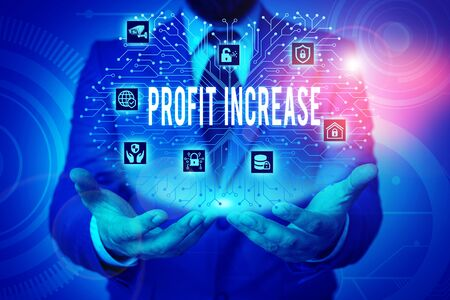 Writing note showing Profit Increase. Business concept for the growth in the amount of revenue gained from a business Male wear formal work suit presenting presentation smart device Stok Fotoğraf