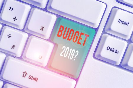 Text sign showing Budget 2019 Question. Business photo showcasing estimate of income and expenditure for next year White pc keyboard with empty note paper above white background key copy space