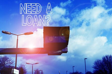 Conceptual hand writing showing Need A Loan question. Concept meaning amount of money that is borrowed often from bank Front view lamp post with two lamps sunny day sky background