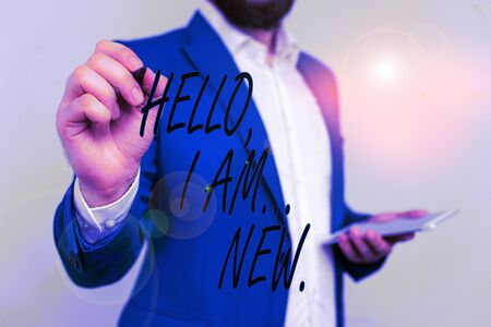 Text sign showing Hello I Am New. Business photo showcasing introducing oneself in a group as fresh worker or student Businessman in blue suite and white shirt pointing with finger in empty space