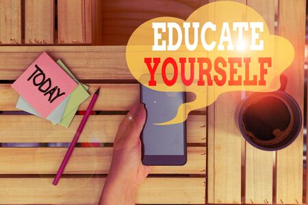 Text sign showing Educate Yourself. Business photo text prepare oneself or someone in a particular area or subject woman computer smartphone drink mug office supplies technological devices