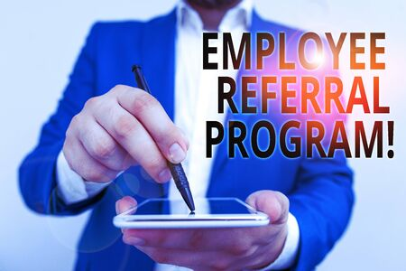 Conceptual hand writing showing Employee Referral Program. Concept meaning internal recruitment method employed by organizations Businessman in blue suite with laptop pointing with finger