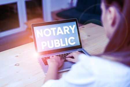Conceptual hand writing showing Notary Public. Concept meaning Legality Documentation Authorization Certification Contract woman with laptop smartphone and office supplies technology Stock fotó