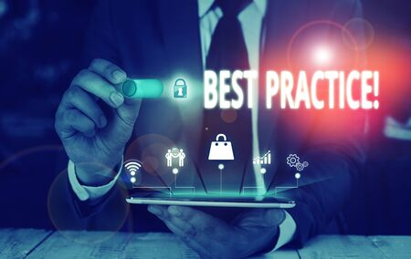 Writing note showing Best Practice. Business concept for commercial procedures that are accepted prescribed being correct Male wear formal suit presenting presentation smart device 스톡 콘텐츠