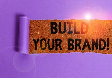 Conceptual hand writing showing Build Your Brand. Concept meaning creates or improves customers knowledge and opinions of product