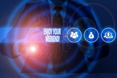 Text sign showing Enjoy Your Weekend. Business photo text wishing someone that something nice will happen at holiday Male human wear formal work suit presenting presentation using smart device Imagens
