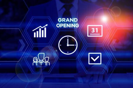 Handwriting text writing Grand Opening. Conceptual photo Ribbon Cutting New Business First Official Day Launching Male human wear formal work suit presenting presentation using smart device