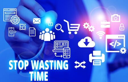 Text sign showing Stop Wasting Time. Business photo text advising demonstrating or group start planning and use it Male human wear formal work suit presenting presentation using smart device