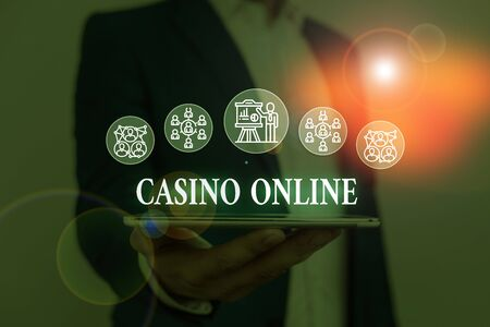 Text sign showing Casino Online. Business photo showcasing Computer Poker Game Gamble Royal Bet Lotto High Stakes Male human wear formal work suit presenting presentation using smart device