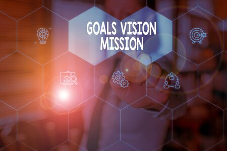 Conceptual hand writing showing Goals Vision Mission. Concept meaning practical planning process used to help community group Woman wear work suit presenting presentation smart device 스톡 콘텐츠
