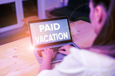 Conceptual hand writing showing Paid Vacation. Concept meaning Sabbatical Weekend Off Holiday Time Off Benefits woman with laptop smartphone and office supplies technology