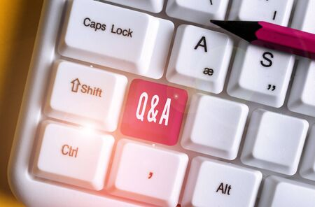 Word writing text Q And A. Business photo showcasing defined as questions being asked and answers White pc keyboard with empty note paper above white background key copy space