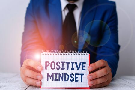 Word writing text Positive Mindset. Business photo showcasing mental attitude in wich you expect favorable results Man holds empty paper with copy space in front of him Space