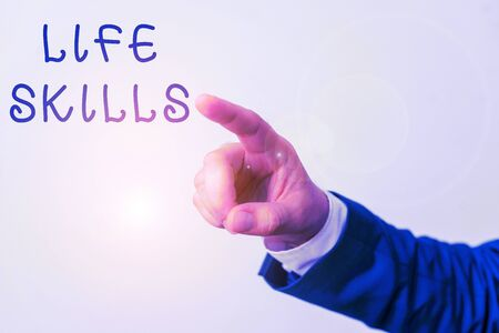 Word writing text Life Skills. Business photo showcasing skill that is necessary for full participation in everyday life Isolated hand pointing with finger. Business concept pointing finger 版權商用圖片