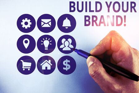 Conceptual hand writing showing Build Your Brand. Concept meaning creates or improves customers knowledge and opinions of product Male designing layout presentation concept for business promotion Stok Fotoğraf