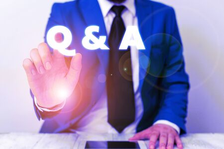 Handwriting text writing Q And A. Conceptual photo defined as questions being asked and answers Businessman with pointing finger in front of him