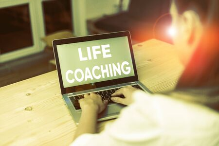 Conceptual hand writing showing Life Coaching. Concept meaning Improve Lives by Challenges Encourages us in our Careers woman with laptop smartphone and office supplies technology 版權商用圖片