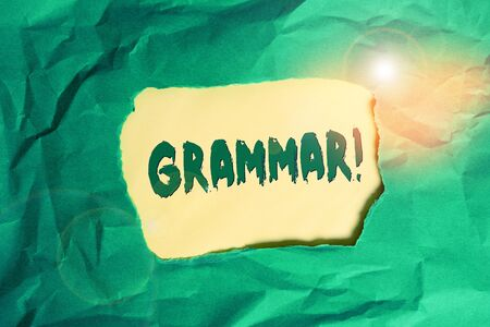 Writing note showing Grammar. Business concept for whole system structure language syntax and morphology Green crumpled colored paper sheet torn colorful background