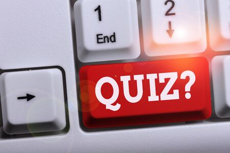 Writing note showing Quiz Question. Business concept for test of knowledge as competition between individuals or teams White pc keyboard with note paper above the white background