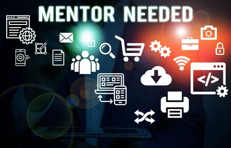 Text sign showing Mentor Needed. Business photo showcasing wanted help for more experienced or more knowledgeable demonstrating Male human wear formal work suit presenting presentation using smart device