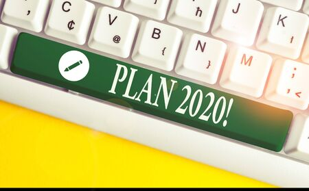 Writing note showing Plan 2020. Business concept for detailed proposal doing achieving something next year White pc keyboard with note paper above the white background