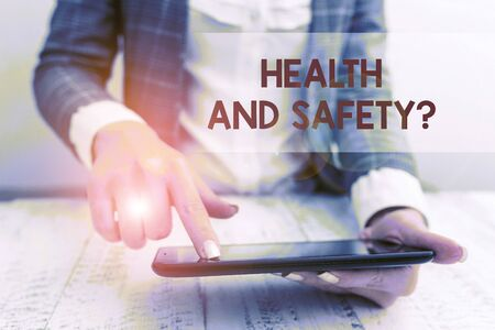 Word writing text Health And Safety Question. Business photo showcasing regulations and procedures to prevent accident or injury Business concept with mobile phone in the hand