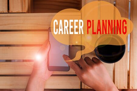 Text sign showing Career Planning. Business photo showcasing Strategically plan your career goals and work success woman computer smartphone drink mug office supplies technological devices