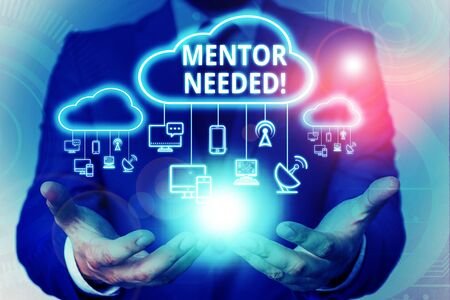 Text sign showing Mentor Needed. Business photo showcasing Employee training under senior assigned act as advisor Male human wear formal work suit presenting presentation using smart device 版權商用圖片