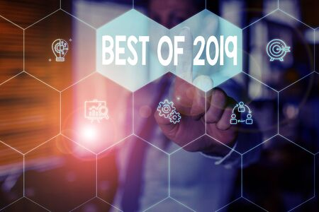 Conceptual hand writing showing Best Of 2019. Concept meaning great and marvelous things and events happened on 2019 Woman wear work suit presenting presentation smart device