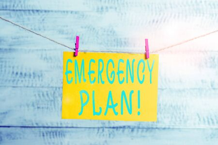 Conceptual hand writing showing Emergency Plan. Concept meaning actions developed to mitigate damage of potential events Clothespin rectangle shaped paper reminder white wood desk