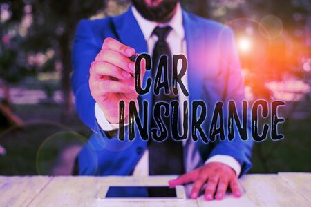 Writing note showing Car Insurance. Business concept for Accidents coverage Comprehensive Policy Motor Vehicle Guaranty Businessman holds pen and points into copy space