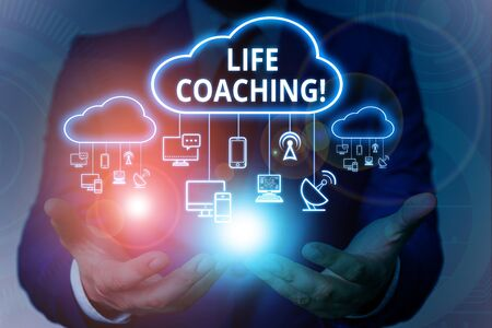 Text sign showing Life Coaching. Business photo showcasing demonstrating employed to help showing attain their goals in career Male human wear formal work suit presenting presentation using smart device 版權商用圖片