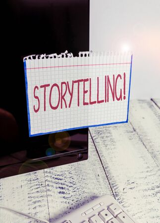 Text sign showing Storytelling. Business photo text activity writing stories for publishing them to public Notation paper taped to black computer monitor screen near white keyboard Stockfoto