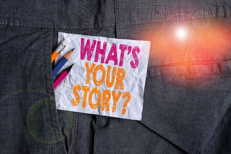 Text sign showing What S Your Story Question. Business photo showcasing asking demonstrating about his past life actions career or events Writing equipment and white note paper inside pocket of man wo