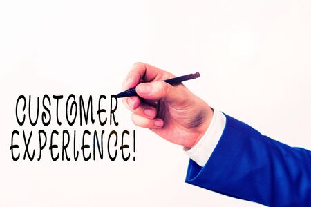 Text sign showing Customer Experience. Business photo showcasing product of interaction between organization and buyer Isolated hand above white background. Pointing pen in the hand on white background