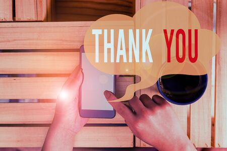 Text sign showing Thank You. Business photo showcasing a polite expression used when acknowledging a gift or service woman computer smartphone drink mug office supplies technological devices