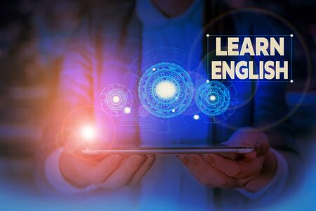 Handwriting text writing Learn English. Conceptual photo Universal Language Easy Communication and Understand Woman wear formal work suit presenting presentation using smart device