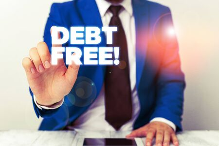 Handwriting text writing Debt Free. Conceptual photo does not owning any money to any individual or companies Businessman with pointing finger in front of him Stok Fotoğraf