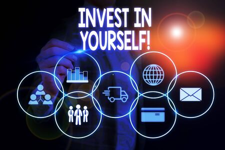 Word writing text Invest In Yourself. Business photo showcasing nvesting in a coach or a training to learn new things Woman wear formal work suit presenting presentation using smart device