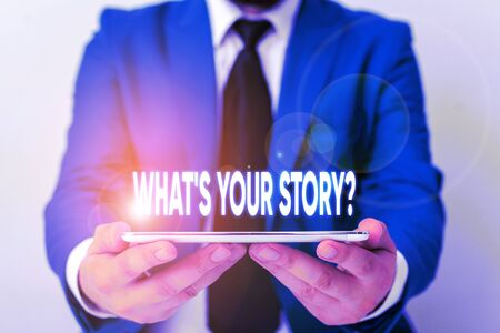 Handwriting text writing What S Your Story Question. Conceptual photo asking demonstrating about his past life actions career or events Businessman in blue suite with a tie holds lap top in hands
