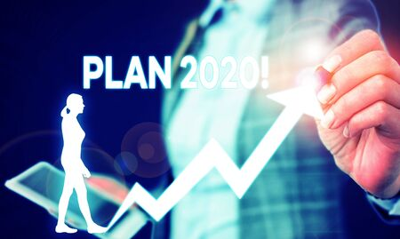 Writing note showing Plan 2020. Business concept for detailed proposal for doing or achieving something next year Female human wear formal work suit presenting smart device