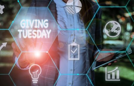 Handwriting text writing Giving Tuesday. Conceptual photo international day of charitable giving Hashtag activism Female human wear formal work suit presenting presentation use smart device Stok Fotoğraf