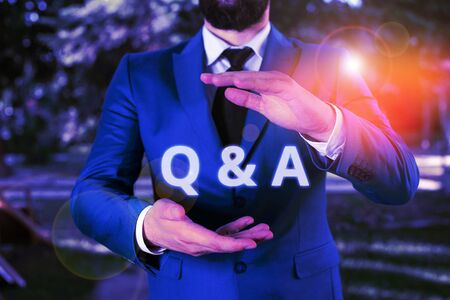 Handwriting text Q And A. Conceptual photo defined as questions being asked and answers Man with opened hands stands in suite. Concept with copy space and man