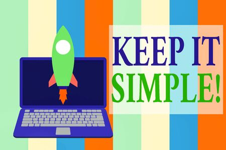 Writing note showing Keep It Simple. Business concept for ask something easy understand not go into too much detail Launching rocket up laptop Startup Developing goal objective