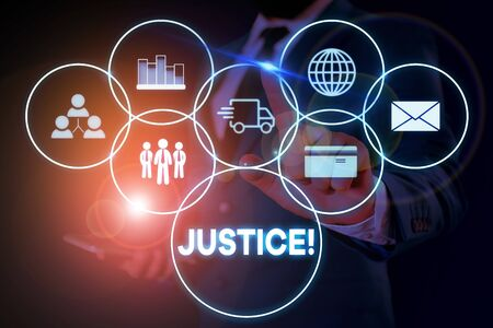 Text sign showing Justice. Business photo showcasing impartial adjustment of conflicting claims or assignments Male human wear formal work suit presenting presentation using smart device Stock fotó