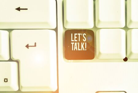 Text sign showing Let S Is Talk. Business photo showcasing suggesting in the beginning of a conversation on the topic White pc keyboard with empty note paper above white background key copy space Фото со стока