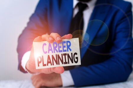 Handwriting text writing Career Planning. Conceptual photo Strategically plan your career goals and work success Man holds empty paper with copy space in front of him Space
