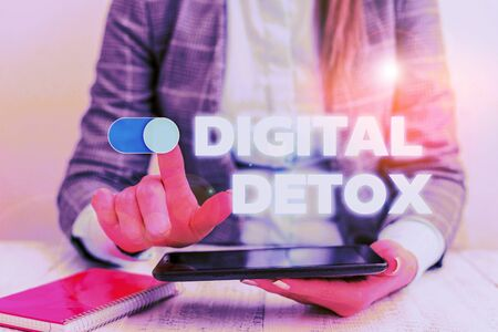 Conceptual hand writing showing Digital Detox. Concept meaning Free of Electronic Devices Disconnect to Reconnect Unplugged Business concept with communication mobile phone