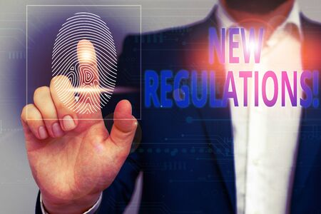 Text sign showing New Regulations. Business photo showcasing rules made government order control something done Male human wear formal work suit presenting presentation using smart device