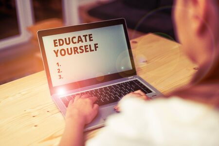 Conceptual hand writing showing Educate Yourself. Concept meaning prepare oneself or someone in a particular area or subject woman with laptop smartphone and office supplies technology